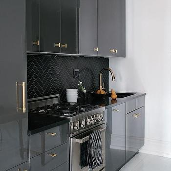 Awesome Gray Lacquer Cabinets With Gold Pulls