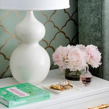 white nightstand with gold bamboo hardware