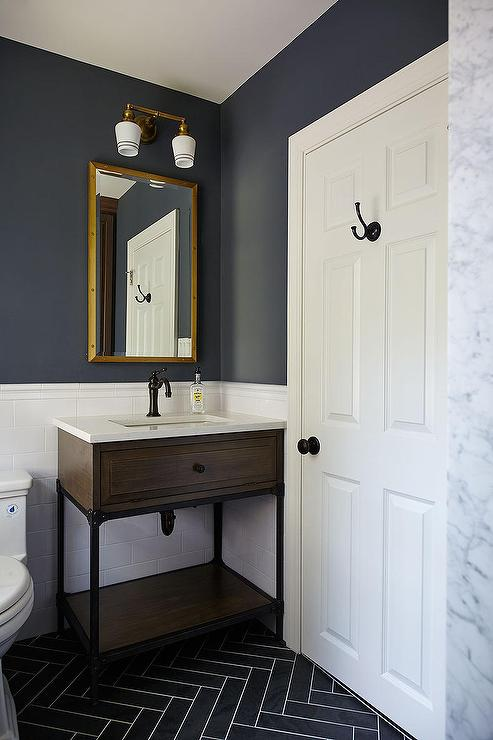 Kids bathroom with gray slate herringbone floor tiles for Dark blue bathroom tiles