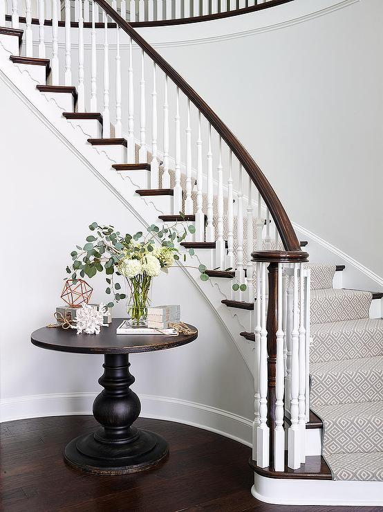 Round table on curved staircase wall traditional for Furniture for curved wall in foyer