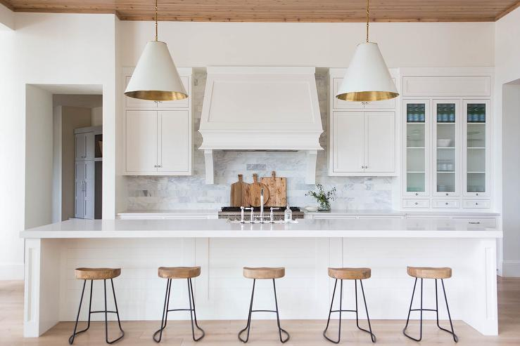 long kitchen island with five stools transitional kitchen