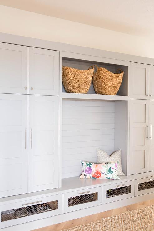 Grey Mudroom Features Gray Cabinets Flanking A Shelf Filled With Woven Baskets Over Bench Stacked Row Of En Wire Drawers