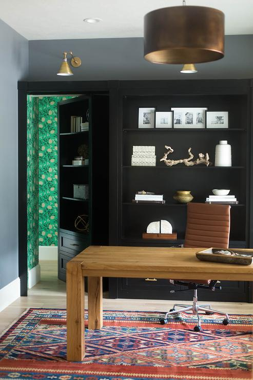 Office With Black Built In Shelves Transitional Den