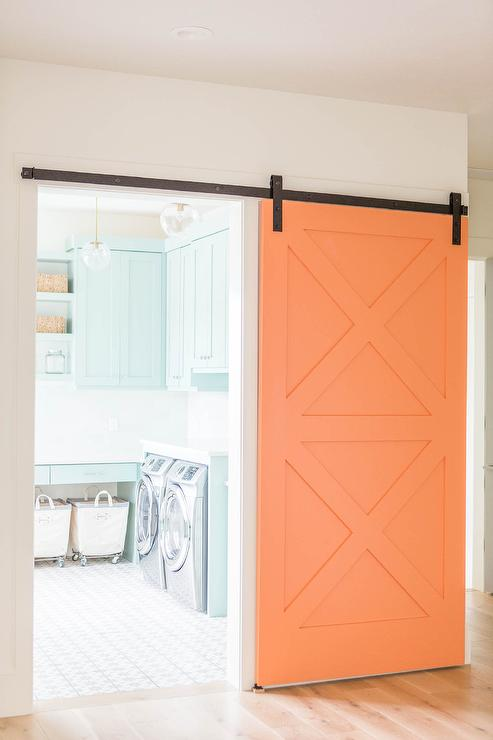 Laundry Room With Orange Barn Door Transitional