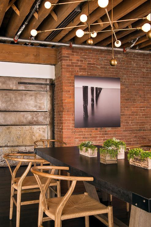 Loft Dining Room With Exposed Brick Walls Modern