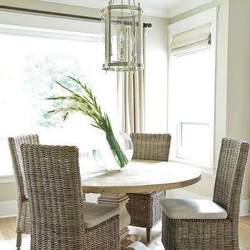Round Salvaged Wood Dining Table With Wicker Dining Chairs