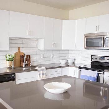 Attractive White Flat Front Cabinets With Grey Quartz Countertops