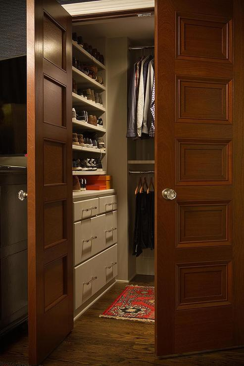 Closet With Paneled Double Doors Traditional Closet