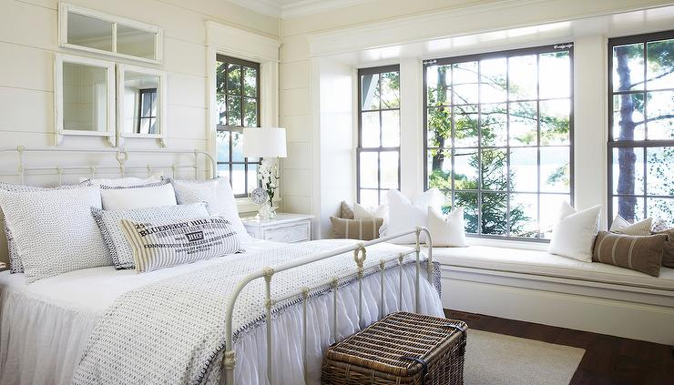 White cottage bedroom with long built in window seat for Bedroom window styles