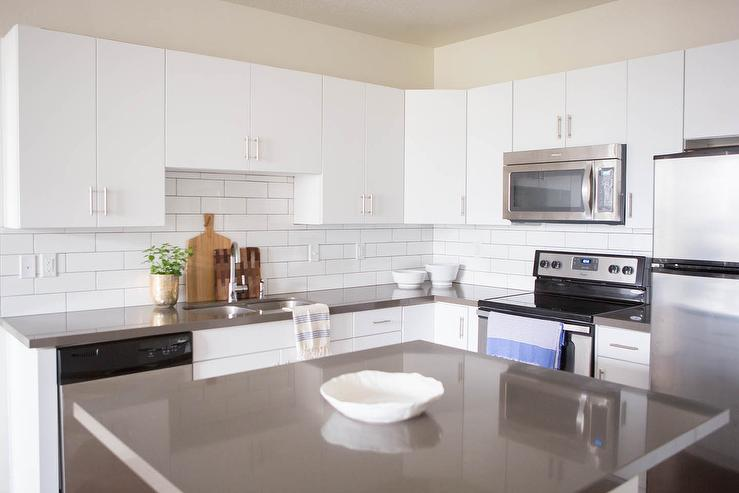 Kitchen Backsplash White Cabinets Gray Countertop white flat front cabinets with grey quartz countertops
