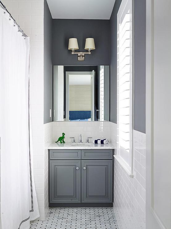 White And Charcoal Gray Bathroom Boasts Top Half Of Walls Painted Lower Clad In Subway Tiles Alongside A Marble
