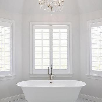 Bay window tub with beaded chandelier transitional for Bathroom designs with bay windows