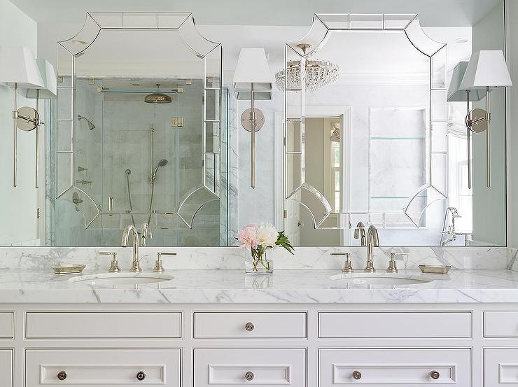 Sophisticated Master Bathroom Boasts A White Custom Washstand Adorned With Nickel Knobs Topped Calacatta Marble Fitted His And Hers Sinks