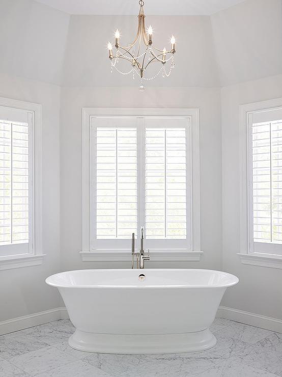 Master bath bay window tub under chandelier transitional for Bay window bathroom ideas