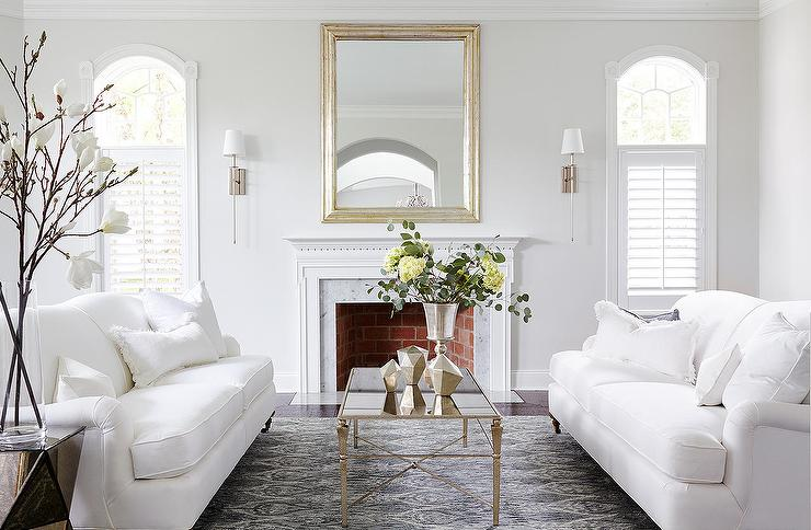 White sofas with an antiqued mirrored coffee table for Living room paper ideas