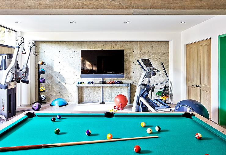 Basement gym with mirrored walls and wood floors Living room gym