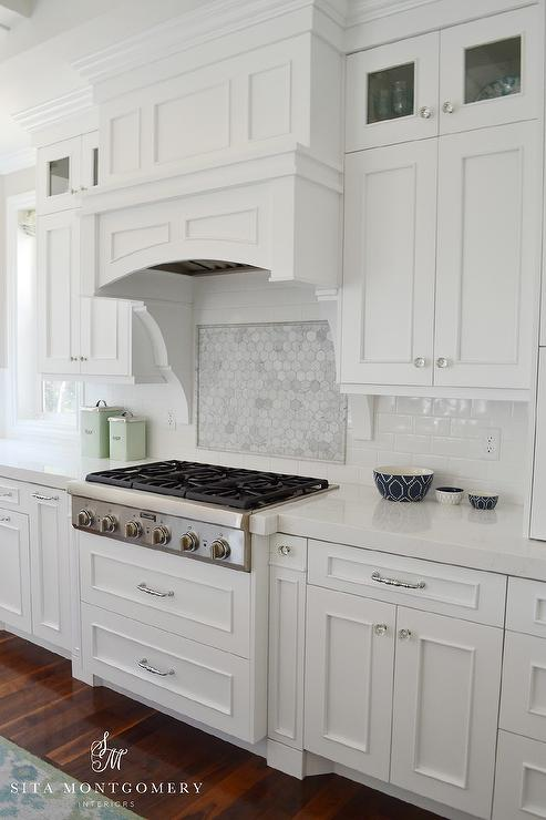 European glass kitchen cabinets - Marble Hex Cooktop Backsplash With Marble Border