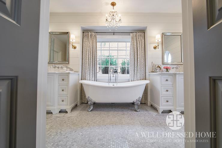 Mirrors over tub design ideas ensuite bathroom filled with a silver claw foot tub placed under window dressed in gray leopard print curtains illuminated by a small crystal chandelier mozeypictures Gallery