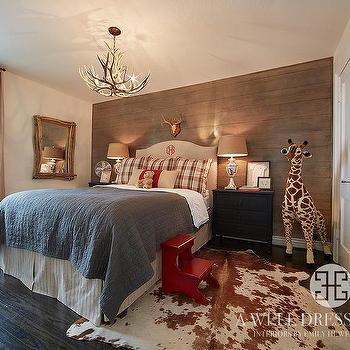 cabin boys bedroom with dark stained book ledges country