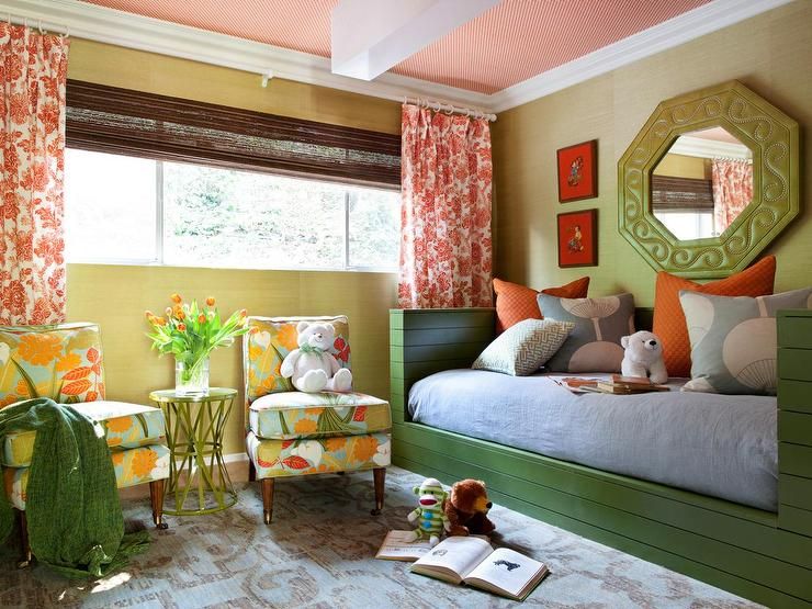 Green And Orange Girls Bedroom Boasts Grasscloth Walls Lined With Octagon Mirror Over A Wood Daybed Dressed In Pillows Gray