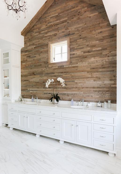 cottage-bathroom-plank-accent-wall-vaulted-ceiling-vanity-dentil-moldings.jpg