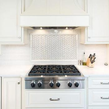 white herringbone cooktop tile backsplash - Kitchen Hood Ideas