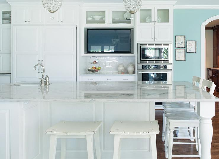 White and turquoise kitchen features walls painted turquoise blue