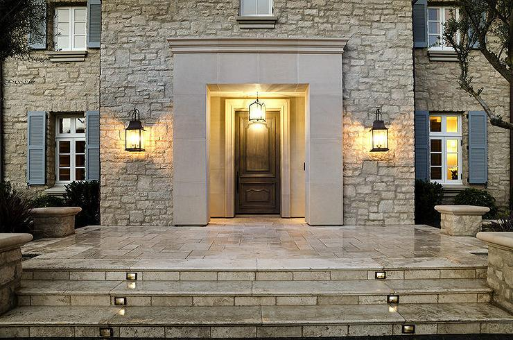 Lighted Steps To Traditional Home With Blue Front Door