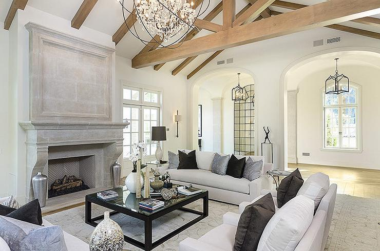 White Living Room With Truss Ceiling