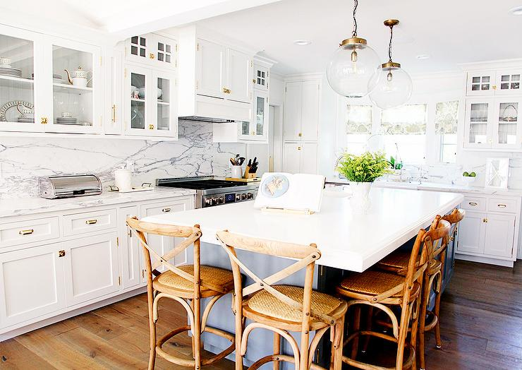 Etonnant Amazing Kitchen Features A Pair Of Clear Glass And Brass Globe Pendants  Illuminating A Gray Center Island Lined With French Cafe Counter Stools,  Ballard ...