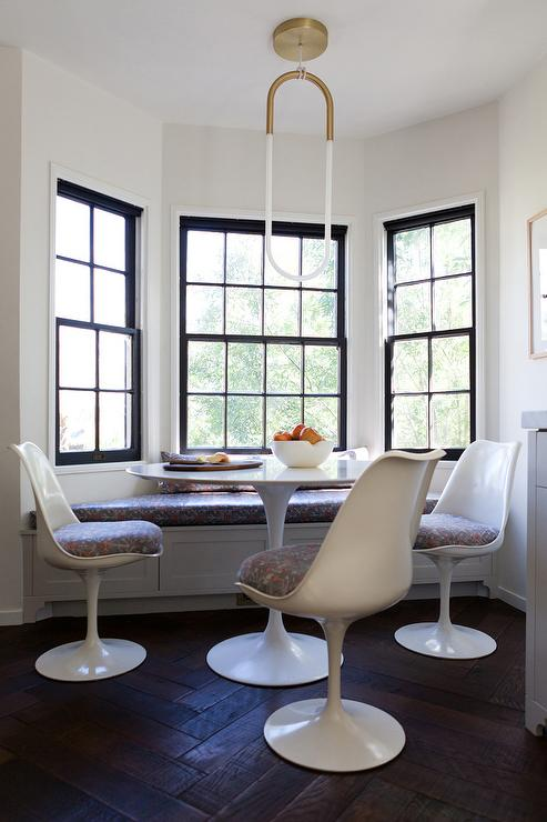 White Pedestal Dining Table With Black Dining Chairs