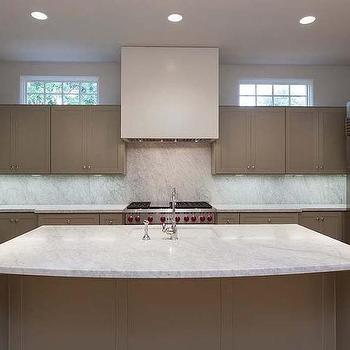 Taupe Kitchen Cabinets With White Marble Countertops And Backsplash