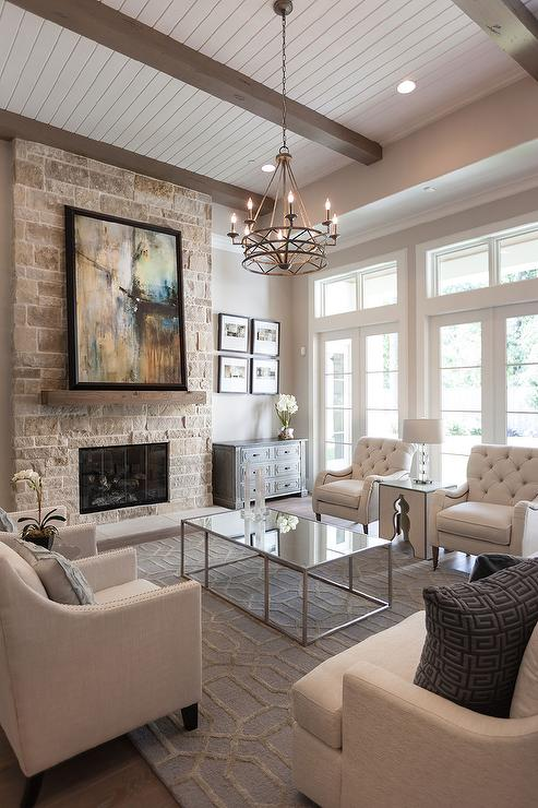 Over the coffee table chandelier transitional living room - Great home interior and exterior decoration with white stone fireplace ...