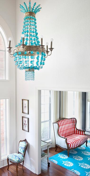 turquoise chandelier lighting. contemporary foyer with a regina andrew turquoise beaded chandelier hanging above french chevron chair near red wingback settee atop blue lighting