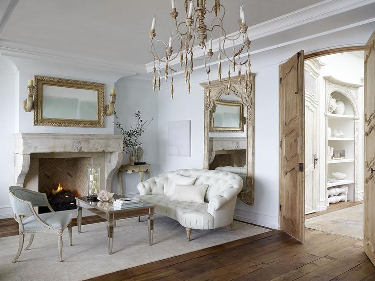 French Living Room With White Tufted Settee And Mirrored Coffee Table
