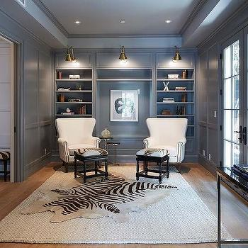 gray den with layered rugs - Den Design Ideas