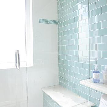 Blue cottage bathroom with blue subway shower tiles for Blue tile bathroom ideas