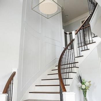 Curved Staircase With Wainscoting