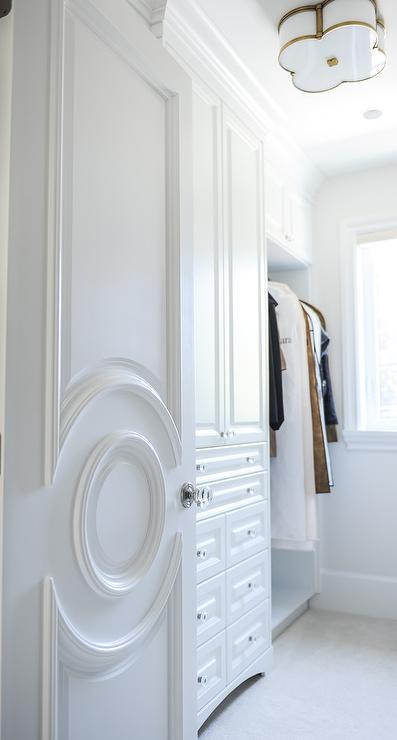 Closet Doors With Circular Moldings Transitional Closet