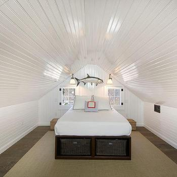 Attic Bedroom With Built In Bed Under Sloped Ceiling