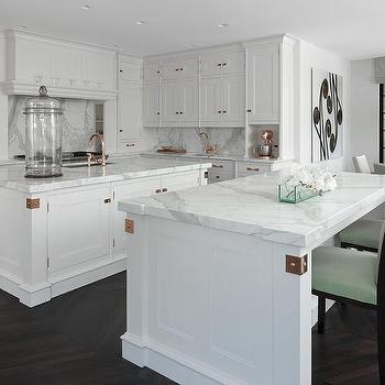 white kitchen cabinets with copper hardware