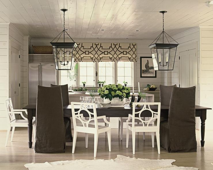 Chic Cottage Dining Room Features A White Plank Ceiling Accented With A  Pair Of Large Cornice Hanging Lanterns Illuminating A Long Dark Brown  Farmhouse ... Part 63