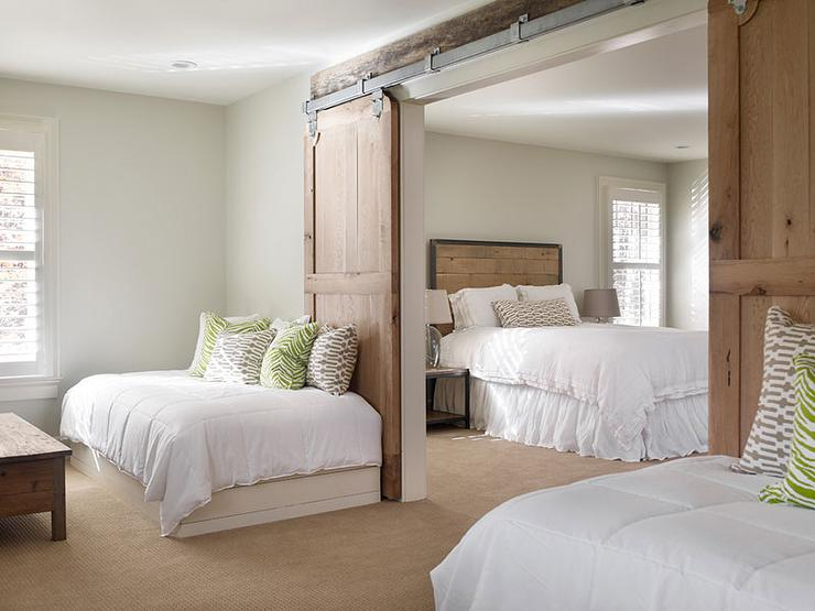 Country Bedroom with Barn Doors on Rails - Country - Bedroom