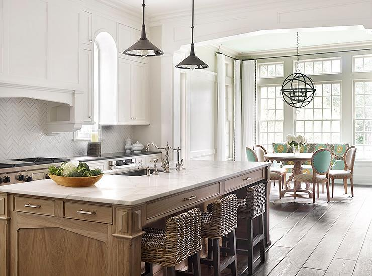 Calcutta Marble Top Island With Wicker Counter Stools Transitional Kitchen