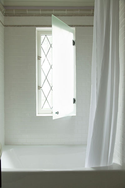 Leaded Glass Window Above Tub Transitional Bathroom