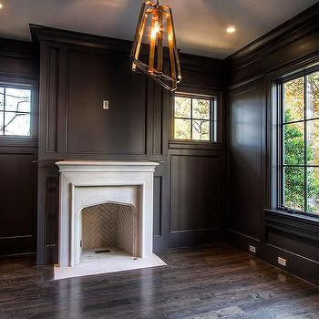black paneled den with white marble fireplace - Den Design Ideas