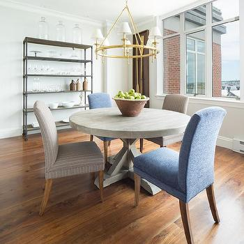 Round Gray Trestle Dining Table With Mismatched Chairs