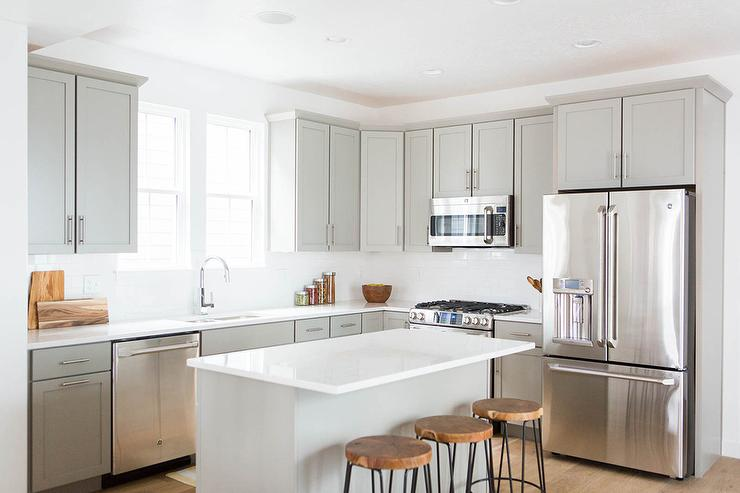 Charming Light Grey Shaker Kitchen Cabinets With White Quartz Countertops