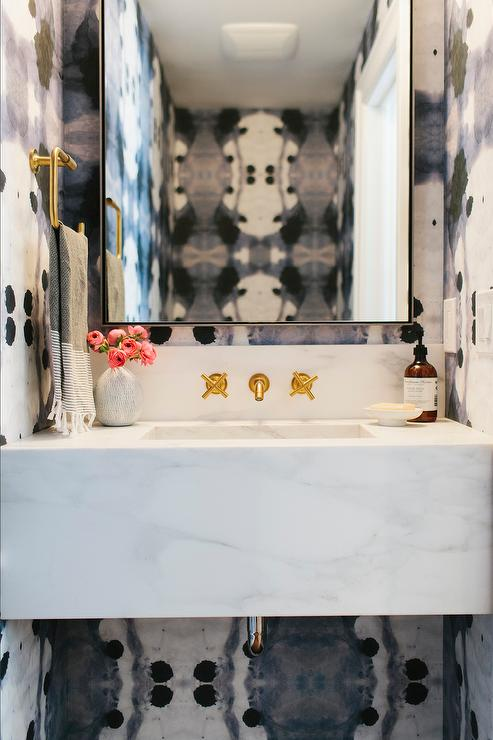 Stunning Powder Room Features Walls Clad In Eskayel Galileo Glass Indigo  Wallpaper Lined With A Marble Floating Sink Vanity Under A Gold Wall Mount  Faucet, ...