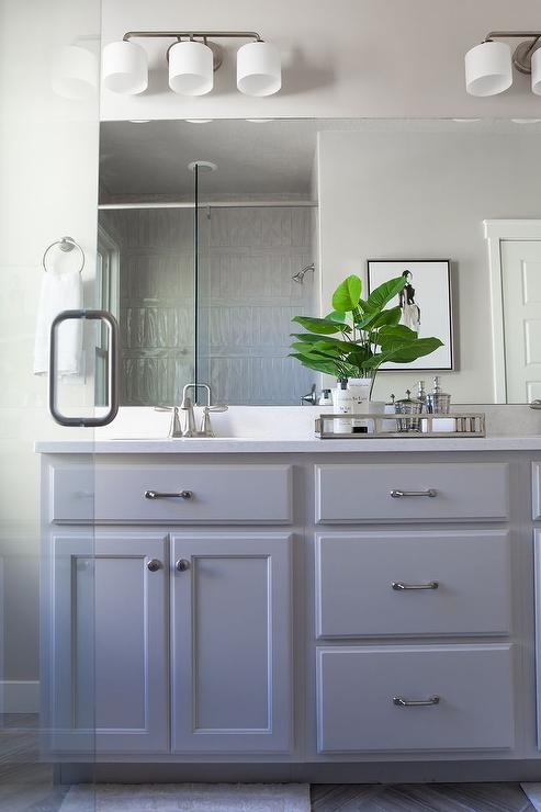 Grey painted bathroom cabinets with satin nickel pulls for Grey bathroom cupboard